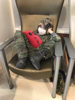 Being cautious and wearing a mask while waiting in the ER.
