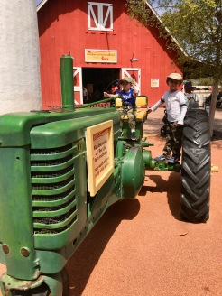 Riding the tractor at the zoo!