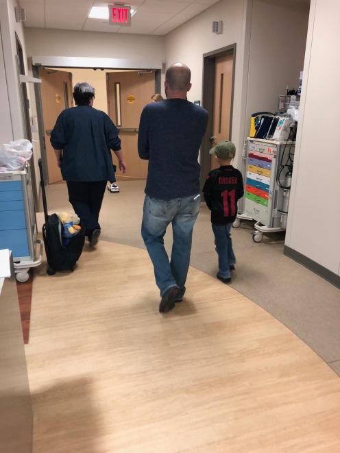 Walking to his last radiation treatment!