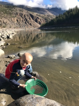 Panning for gold down by the river.
